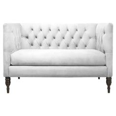 Diamond-tufted settee with a pine wood frame and foam cushioning. Handmade in the USA.   Product: SetteeConstructio...