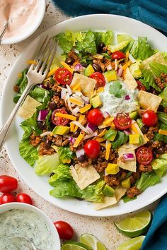 Long live taco salads! I grew up on taco salad - of course it was the classic Doritos taco salad that everyone was eating in the 90's and yes sometimes I still crave that but I prefer this healthier version by far! Here I've made a taco salad filling with lean ground turkey, black beans, tomato paste, chicken broth