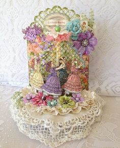 By Melissa Torres Divelbiss using a mixture of Sweet Sentiments, Secret Garden and Nutcracker Sweet stamps with paper-pieced dresses G45