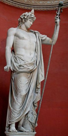 Colossal statue of Antinous as Dionysos-Osiris (ivy crown, head band, cistus and pine cone). Marble, Roman artwork. Museo Pio-Clementino, Sala Rotunda - Vatican Museums