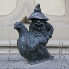 Pigeon Keeper. The dwarf on a pigeon sitting on a ledge of Spiż Restaurant in Wroclaw's Market Square can get grumpy. Before the Internet and text messaging he was the oh-so-awaited messenger around the world. Today he just ponders the old times…