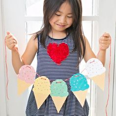 Download this free printable ice cream cone garland in 8 colors for a party or cute kids room decoration!