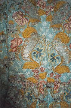 Detail of brocade, showing metallic threads. Dress, mid-18th c., French, silk & metallic. Metropolitan Museum of Art.