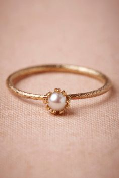 I love this ring!  Simple and pretty.   Mermaids Coronet Ring from BHLDN
