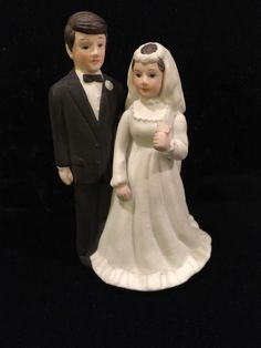 A personal favorite from my Etsy shop https://www.etsy.com/listing/258879386/vintage-wedding-cake-topper-brunette