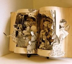 """The Land of Fairy tales is altered book constructed from a book dated 1923 called Fairy Land. It is beautifully carved to tell the story in sculpture form."" By Raidersofthelostart, via Etsy."