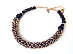 COLLANA NERA E ORO tessitura di perline in di ERYCOLLECTION, $65.00