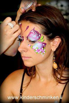 Gorgeous butterfly face paint design.