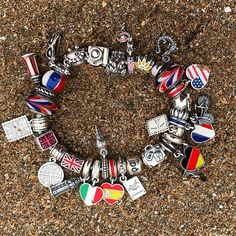Some of my #pandora #travel #charms on the #beach #dopandora #pandorabracelet #charmbracelet #italy #spain #holland #dominicanrepublic…