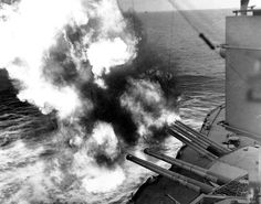 Forward battery of the USS Nevada firing on targets at Utah Beach, DDay.