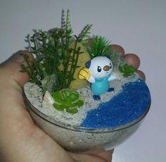 Mini miniature artificial terrarium diorama ornament decoration Handmade Oshawott Pokemon habitat ball To see all the Pokemon habitat balls I have made or to place an order, please visit my Facebook page https://m.facebook.com/sparklesandstring/