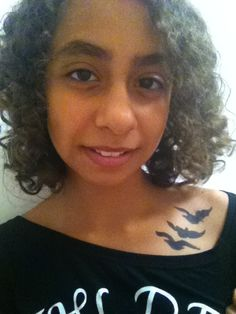 I GOT THE TRIS TATTOO! It's temporary. I drew the design myself and then my sis traced it on my collarbone!