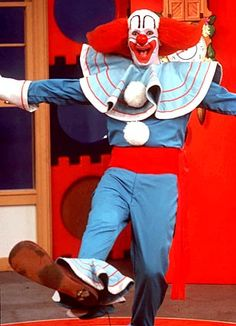 Bozo the Clown. Funny...I don't remember him being this scary looking when I was young.