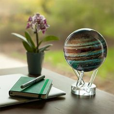 Looking for a unique gift for him? How about a Solar Globe? The best part of this desk accessory is that it moves without you touching it. This version of Jupiter uses low-light solar cells and the Earth's magnetic field to allow the gas giant's clouds of ammonia crystals to glide by while you watch. For a force of nature so turbulent, it's all very soothing