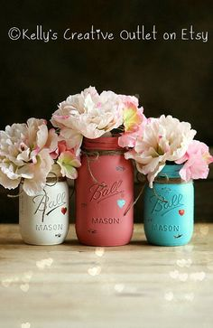 "Perfect for her!   This listing is for 3 jars (2 pint sized and 1 quart sized). They are painted a beautiful combination of Terra Cotta, teal, and antique white. Each jar is first painted with antique white, and then 2 more coats of the actual color. You can use them to hold candy, flowers, or anything that your ""heart"" desires. ♥ The silk flowers are not included."