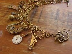 From Gryphon Design, New Zealand, this charm bracelet is on a hand-made chain created using brass and copper links.The charms are mostly vintage watch and pocketwatch parts including a small watch face and hand as well as many internal pieces. Perfect for a Goth/Steampunk wedding.