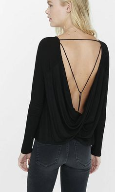 With dolman sleeves and thin, strappy details this tee is the ultimate mix of soft and sexy. Our ultra soft Express One Eleven fabric drapes lush jersey over your shape and dips dramatically low in back for a wow-worthy flash of skin.