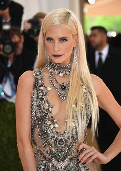 Must-See Beauty Looks from the 2016 Met Gala Red Carpet | Poppy Delevingne with sleek long blonde hair and a vampy dark lip