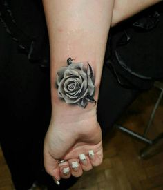 Grey rose wrist tattoo. Love the detail and intensity of the flower.