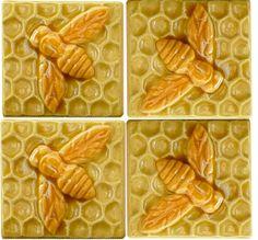 Four Ceramic Yellow Bee tiles sculpted by Beth Sherman of www.HoneybeeCeramics.com