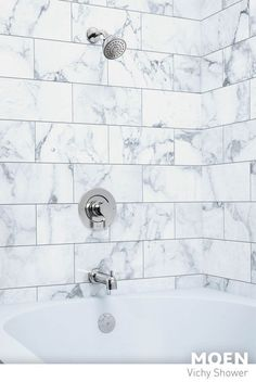 The mid-century modern style of our Vichy collection elegantly complements the natural marble tiling of this bathroom.