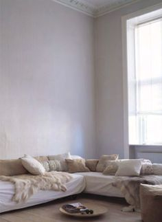 neutral colors, textures, basket vs. table, orientation along walls/underneath window