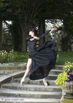 Ballet dancer descending the garden stairs in a billowing black gown.  Photo Gene Schiavone