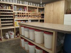 For the dry pantry side it would be nice to build shelving for home canned goods and store purchased goods like these soup can dispensing shelves.