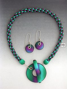 Extruder Madness by Bettina Mertz. Great use of the extruder to create seed beads.  Love the color blends.