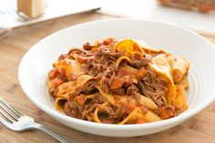 Flank steak is a lot leaner than short ribs and shreds beautifully to make a slow cooker ragu that's tossed with fresh pappardelle pasta.