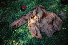 Improvised photo shoot by Massimo Osti on the grass, Ice jacket with his glasses and personal items
