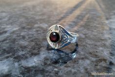 Bailey Celtic Ring in Silver with 6.5mm Red Garnet