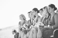 Bridesmaids during a beach wedding ceremony at Westhampton Bath & Tennis in Westhampton, NY. Captured by NYC wedding photographer Ben Lau.