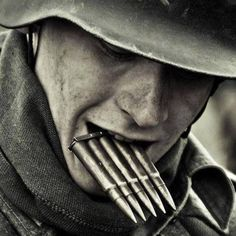 Lone Wehrmacht soldier( holding in his mouth extra ammo, a Five clip for his Kar98 rifle.)16