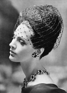 Black net turban with net voilette by Gilbert Orcel, jewelry by Renel. Photo: Roland de Vassal, 1962.
