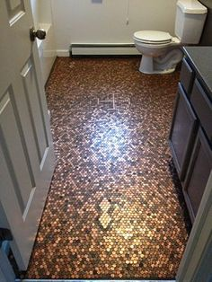 Make a Penny Floor/Renovate a Bathroom for Under $400...perfect for laundry room and powder room!  AWESOME