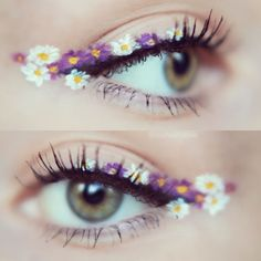 This is a really nice eyeliner look, I really love how the winged liner is made up from the little flowers. The flowers look like they're made from white liquid eyeliner, and purple eyeliner.