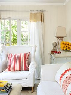 Gauzy curtains hang high, making the living room's French doors a focal point.