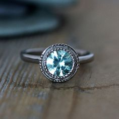 Love this color!!! The setting... meh...  Blue Zircon Vintage