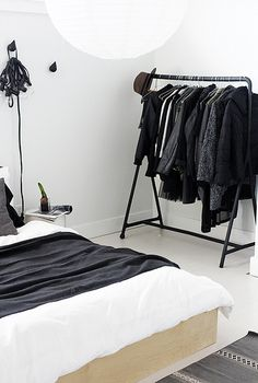 nice solution to nonexistent closet space -- I'd paint the clothes rack blue or green.