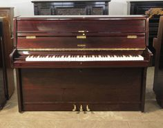 Wesberg upright piano with a mahogany case from our affordable, starter piano range £600. Bid now!