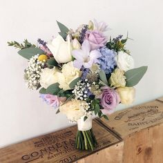 A dreamy palette of lilacs, baby blue, champagne and yellow accents.