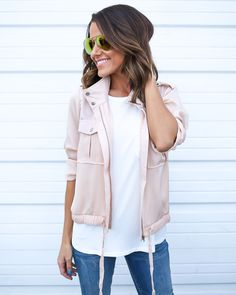 Say hello to your new favorite Spring lightweight jacket! This blush, silk like, utility jacket is a styling must have! The front pockets and snap closures are chic and on trend! This jacket zips up t