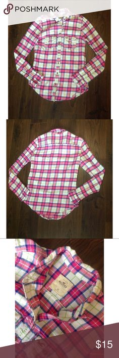 Hollister flannel 🖊D e s c r i p t i o n 🖊 This top is a fun colorful plaid. That is perfect for any season. It was never worn but the tags arnt on it.   ⚫️C o n t e n t⚫️ 100% cotton   ✂️M e a s u r e m e n t s ✂️ Extra Small  🔘C o n d i t i o n 🔘 New without tags  👖👚P a i r W i t h 👚👖 Jeans or shorts  🚫 No trades 💕 Reasonable offers welcome  💰 Bundle discount offered  📬 Ships in 1-2 Hollister Tops Button Down Shirts