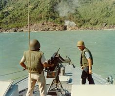 A Coast Guard ship fires on a cave suspected of being a Viet Cong hideout, 1966.