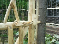 Handcarved cottage garden gate latch detail. From The Creative Coppice Co.