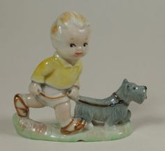 Wade made two figures Sam and Sarah under license to designs by Mabel Lucie Attwell. Both the children are portrayed with their pet dogs. According to the excellent Wade book by Pat Murray they originally cost 6/11d and were available from October 1959 until the Summer of 1961.
