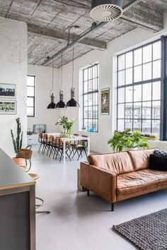 How amazing is this industrial-style loft? The hight ceilings and huge windows are stunning. The plants dotted around the room stop the style from being too harsh. It's a real winner.