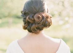 Neat up do for the bride via Wedding Sparrow blog www.weddingsparrow.com