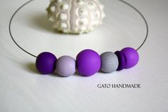 Unique necklace curated with beads Unique polymer by GATOHANDMADE Unique Necklaces, Unique Jewelry, Polymer Clay Necklace, Eye Necklace, Beads, Trending Outfits, Purple, Creative, Handmade Gifts